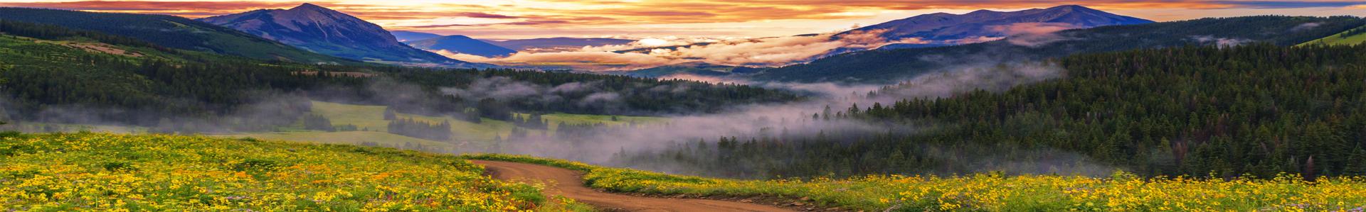 Misty mountain scene at sunset